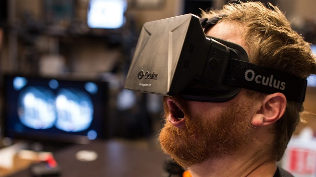 An Oculus user gets immersed into the virtual world.