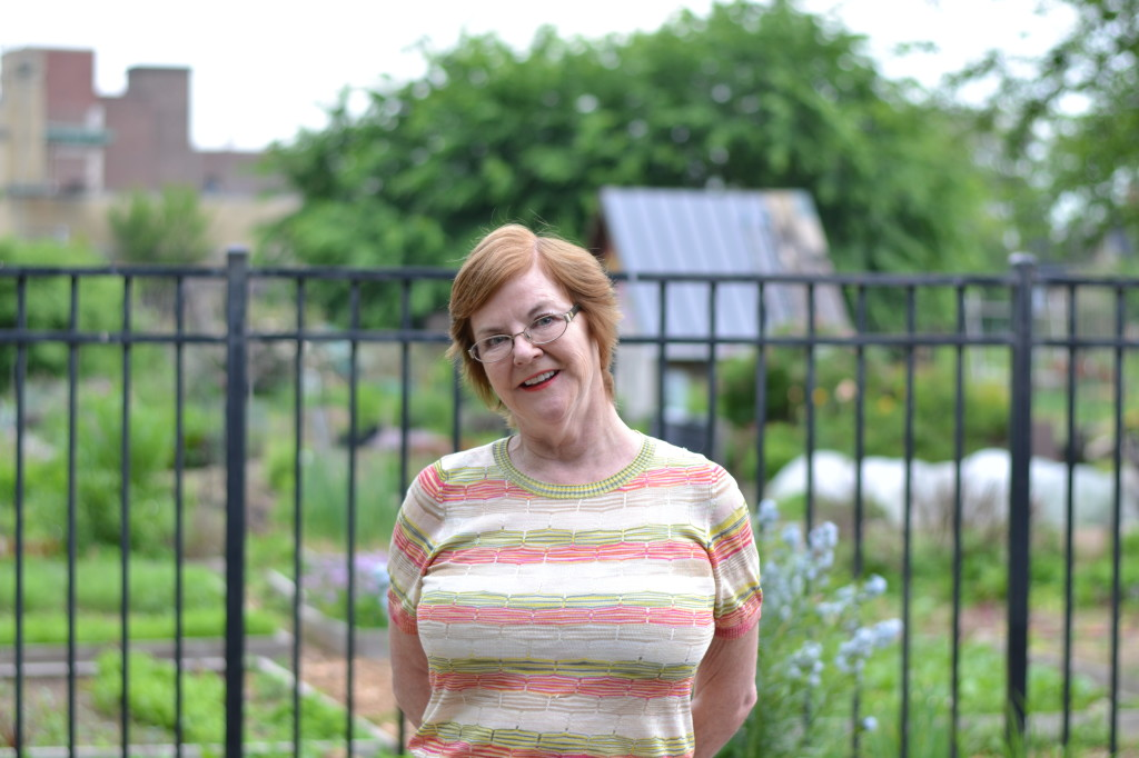 Margaret McCarvill, Board President of the Neighborhood Gardens Trust poses at the Summer Winter Community Garden near Drexel University.